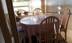 Beautiful dinette with extension and 4 chairs. Light colour. Like new, table and chairs always covered. Must sell. No kids, no pets, non smoker. Cash and carry. Negotiable.