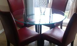 asking $450 negotiable. Round glass dinette with dark wood base and 5 red faux leather chairs. pick up only.