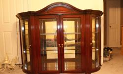 """Great solid cherry wood dining room set in excellent shape. Table is 74"""" long 42""""wide 103"""" with leaf in. 2 arm chairs and 4 regular. China cabinet is 75""""wide 20"""" deep 85"""" high with lights, mirrored back and glass shelves. Top of cabinet is in our spare"""