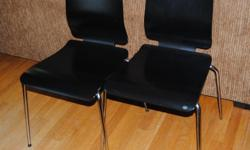 Two dining chairs in excellent condition. Wood with chrome legs.