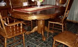 Dining Table and six chairs , two are captains chairs and china cabinet.