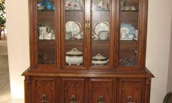 Oak dining room set including :-  table 64 ½ X 40 ½ with extra leaf 16 in.  2 arm chairs  4 straight chairs and illuminated china cabinet (not including contents).