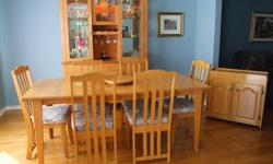 """Dining Room Table with 1 leaf, a lazy susan, 6 chairs, and a server are all made by Erel in solid Oak wood, approximately 30 years old. Dimensions of table: 73"""" full length with leaf, 59"""" without leaf, 36"""" wide. Dimensions of server: 32"""" wide, 15"""" deep,"""