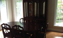 -Includes 4 chairs,1 captain chair,1 table,1 table panel,1 buffet with a glass hutch. -Made in Canada by Broy Hill