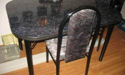 Black marble dining room table with gold trim.  Call 222-9999 if interested. Chairs not included.