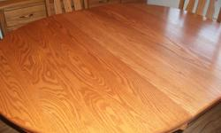 Amish Oak Dining Room table. round 48 -48 with one leaf 48-60 with two leaves 48-72 Pedestal Table. Beautiful made wanting to trade for a smaller table or sell so we can buy a smaller one.
