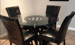 """48"""" round glass table on a wooden base with 4 leather chairs. Almost new. Yonge and Eglinton Ave area."""