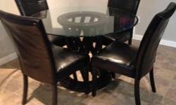 """48"""" round glass table on a wooden base with 4 leather chairs. Like new. Paid $1200. Yonge and Eglinton Ave area."""
