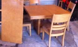 4x4 table with 4 chairs and a 2 foot leaf. Center pedestal, as opposed to four legs, with a lower drawer. This ad was posted with the Kijiji Classifieds app.