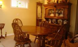"""This beautiful set consists of large two leaf table with six chairs includes two captains chairs, china cabinet 75"""" high by 60"""" wide and a server 36"""" high by 39"""" wide. all made of solid wood I think Oak. North Carolina made, excellent condition with just"""