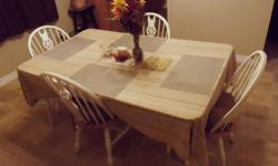 Dining room table and four chairs for sale. Table measures 5' long by 3' wide.