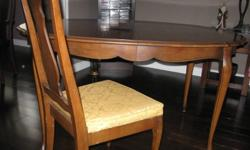 Solid Cherry Wood table and 4 chairs. Also comes with 2 leafs. Without leafs( as in pics) the table is58 inches long and 42 inches wide.        The matching hutch is also solid cherry wood and in great condition.