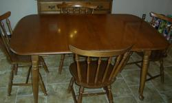 New Brunswick Maple dining room table with two leafs and six chairs, plus matching hutch in good shape. Need them gone as we just got a new set , just reduced to $425 OBO Call 491-0632