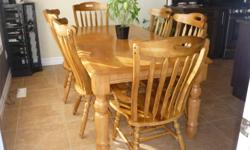 """Solid wood table and chairs in excellent condition.   72"""" x 38"""""""