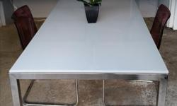 Gorgeous tempered glass table (IKEA) seats 4 - 6. In excellent condition. In Ladysmith