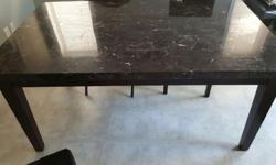 We are moving and don't have room to take our beautiful table with us so we are selling. The set is black; the table is REAL marble ( very heavy ) and comes with 4 black leather chairs. There is a chip in one of the corners which is what effects the