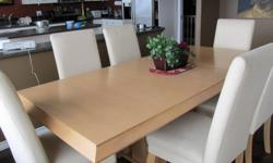 Beautiful light oak coloured pedestal dining table with six cream cloth covered chairs.  In terrific condition.  Have no space for it in my new house. Was expensive when new and would look great in your house! Just in time for Christmas dinner!