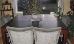 Nice Pub style dining table set...with large leaf...chairs are very comfortable..perfect for entertaining