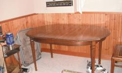 dinning room table with 2 leaf 4 reg. chairs 2 arm chairs $300.00