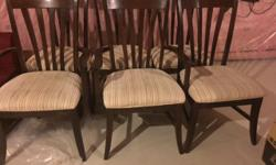 Dinning Table in excellent condition, walnut colour with 6 chairs and extendable unto 8 chairs