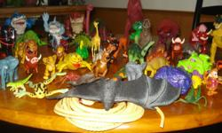 Dinosaurs, Lion King and other figures. Well over 30. All in good condition and clean.