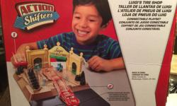 Bought new and in good condition. Lightening McQuinn is included. Product details: https://www.amazon.ca/Disney-Action-Shifters-Luigis-Playset/dp/B00EUY4IQE The Action Shifters lever allows kids to play out stories in each set and launch their cars out of