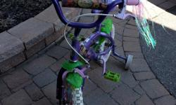 "This is a used, but in excellent condition, girls 12"" Disney Fairies Bicycle"