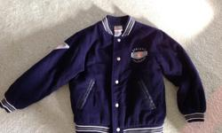 This is a size M.....Athletic collection.....TIGGER ...jacket.. Bought for Grandson, but too small... Dark Blue Melton with lining....leather trim around pockets... Beautiful embroiderie. .... Looks great on.... Very classy for a little guy or girl.....