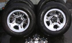 Four 17 inch Dodge Ram Stock OEM Chrome rims, tires, center caps and lug nuts . Rims are in excellent condition no curb rash, scratches or blemishes. Tires are HERCULES P245/70R17, these are mud and snow tires. Tires only have 2000 km, they are New. Price