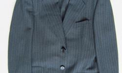 Dolce & Gabbana Men's Suit Dark Blue, 2-button (picture may not accurately portray) Size: European sizing, approx. Canadian size 40 Please send your approx. height, weight, waist and neck size, in order to make a proper determination re fit. Immaculate