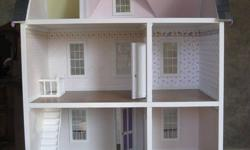 For sale is a finished dollshouse. It includes to sclae wallpaper, window, floor and ceiling trim and functioning doors, just like the real thing. The house is made in 1/12 scale and measures 24in by 18in and 29in in height. See seperate adds for