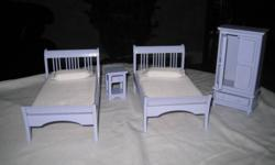 For sale is a 1/12 scale children's room furniture for your dollshouse. It includes two beeds, a wardrobe and night table. The furniture has never been used. If interested please call 519 542-1595.
