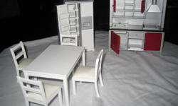 For sale is a 1/12 scale modern kitchen unit for your dollshouse. It has never been 'used'. If interested please call 519 542-1595.