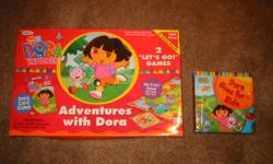 Dora Adventure floor mat game.  All the pieces for the game are here.  The box says it also comes with playing cards, but those are not included.  We lost some of them. Also includes a Dora Board book.  Asking $5.00 for all. We are a clean, smoke and pet