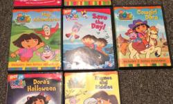 7 DVD's all sold as a set Super Silly Fiesta! Save the Day! Rhymes and Riddles Cowgirl Dora Map Adventures Dora's Halloween Big Soster Dora