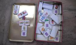 Beautiful full set of Dora Dominoes, white background with full colour images of Dora characters, in tin. See my seller's list for other Dora the Explorer merchandise.