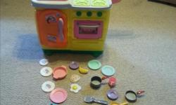 Dora kitchen set. Very good shape. Includes some kitchen dishes to play with.