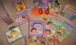 Selling a huge lot of Dora items in perfect used condition. - dora lunch box - 8 figurines - light up pen - puzzle - dance-along musical adventure dvd with play clothes, maracas and mat. - 9 dvd's - dominoes - 2 board books - 2 paper back books - Dora's