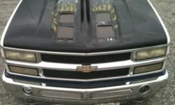 Selling my hood from my 96 chevy 1500 reason for selling, buying an new truck ... The hood has custom painted flames and skulls Front hood covers are missing but looks better with out them!!! Small dent on the front not to bad you can't notice it from