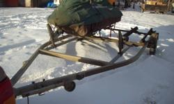 """Ezloader Double seadoo trailer fully adjustable.  2""""ball  fully adjustable bunks and winch.  Tows great!  Will trade for single trailer plus cash.   email only please thanks"""