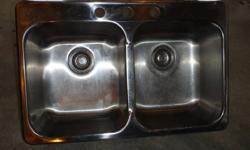 This used sink has double bowls.  They are not dinted or damaged and are equal in size.  They are each 14 X 16 X 8 inches inside.  They are stainless steel construction and the outside measurement is 31 ¼ X 20 ½ inches.  All the clips, drain hardware and