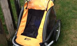 In good used condition. Great for running or attach to the bike. Very comfy for kids.