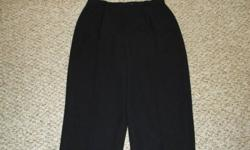 Dress black pant.  Size 12.  Pant is a semi-sheer crepe fabric with a full taffeta lining.  Pants are wrinkle free.  Elegant and comfortable.  Front zipper and button waist.  Perfect for the Christmas Party or New Year's Eve.