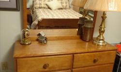This solid maple wood dresser has six drawers and attached mirror. The matching night table has one drawer. Good condition. Cash only.