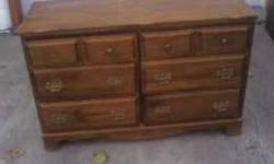 solid does need a light refinish has a small chip on the one side but small like said drawers are very clean and do work well can be viewed in brantford or delivered  for free
