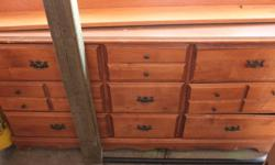 Strong dresser set Tall and long dresser. Just being stored and ready to be moved. Can deliver within reason