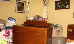 Old wood dresser with mirror.  Have relocated and must downsize.