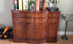 This set was made in September of 1964 and is from the Drexel Travis Court Mahogany Collection. It has all the appropriate stamps and tags to verify its authenticity. The pieces are quite beautiful and in excellent condition. We will sell the pieces