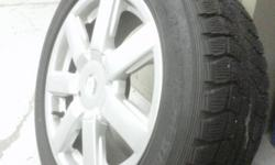 Winter tires with aluminum wheels like new.  Used on Mercedes C230 coup.  only 4000km on it.  Wheels have two set of five hole pattern may fit other type of car.   asking $650 for a set.   please call 647 287 3359   Leslie