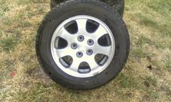 Dunlop Studless, Graspic DS 2 - 205/60R15 -Tires are only 5 months old, Great tread on them. -Tires come with manufacture rims. -Perfect condition, bought a new car, and they don't fit. -Tires came off a Mazda 626, 5 bolt pattern Contact at cell